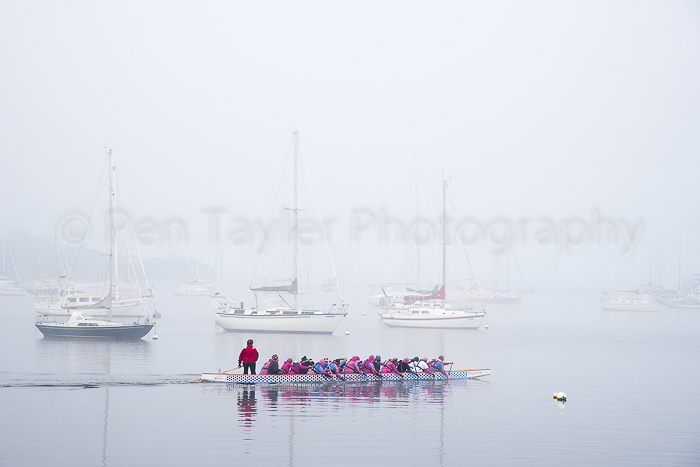 Dragon boats in the mist